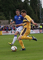 Scott Lawrie crosses as Ross Perry Perry covers in the Forres Mechanics v Rangers William Hill Scottish Cup 2nd Round match, at Mosset Park, Forres on 29.9.12.