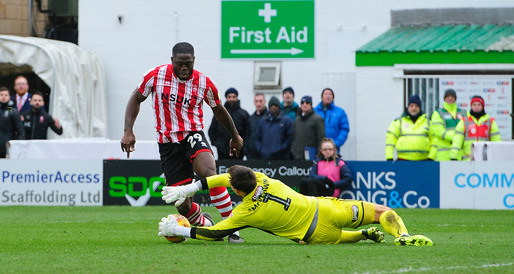 Grimsby Town's James McKeown saves at the feet of Lincoln City's John Akinde<br /> <br /> Photographer Chris Vaughan/CameraSport<br /> <br /> The EFL Sky Bet League Two - Lincoln City v Grimsby Town - Saturday 19 January 2019 - Sincil Bank - Lincoln<br /> <br /> World Copyright &copy; 2019 CameraSport. All rights reserved. 43 Linden Ave. Countesthorpe. Leicester. England. LE8 5PG - Tel: +44 (0) 116 277 4147 - admin@camerasport.com - www.camerasport.com