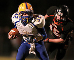 HOWARD, SD - NOVEMBER 8:  Colin Walth #32 from Alcester Hudson looks for room past Bailey Neises #45 from Howard in the first half of their Class 9A Semifinal game Saturday night in Howard. (Photo by Dave Eggen/Inertia)