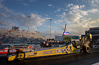 Sep 13, 2013; Charlotte, NC, USA; NHRA top fuel dragster driver Morgan Lucas (near) races alongside Clay Millican during qualifying for the Carolina Nationals at zMax Dragway. Mandatory Credit: Mark J. Rebilas-
