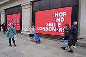 Shop and Smile Londoners. Selfridges end of year sales, Oxford Street, London.