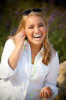 Blonde Teenage Girl With Ipod Laughing