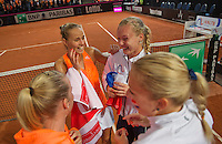 Februari 08, 2015, Apeldoorn, Omnisport, Fed Cup, Netherlands-Slovakia, The winning Dutch team ,.tlrl:  Richel Hogenkamp, Arantxa Rus, , Kiki Bertens and Michaella Krajicek<br /> Photo: Tennisimages/Henk Koster