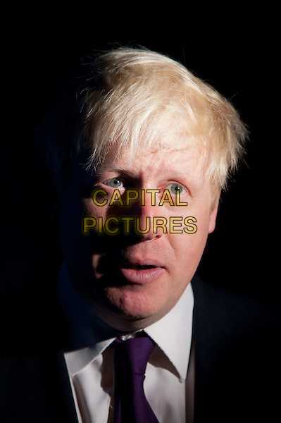 The Mayor of London Boris Johnson visits the London Aquarium's newest attraction, the shark tank, to promote the range of summer promotions available to Londoners and tourists alike, including 2 for 1 ticket offers and money off promotions. London Aquarium, London, England..August 17th, 2012.headshot portrait black white purple tie shirt suit   mouth open.CAP/BF.©Bob Fidgeon/Capital Pictures.