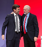 © Joel Goodman - 07973 332324 . 28/09/2016 . Liverpool , UK . Greater Manchester Mayoralty candidate ANDY BURNHAM shakes hands with JEREMY CORBYN after delivering his final speech as shadow Home Affairs spokesman , during the final day of the Labour Party Conference at the ACC in Liverpool . Photo credit : Joel Goodman