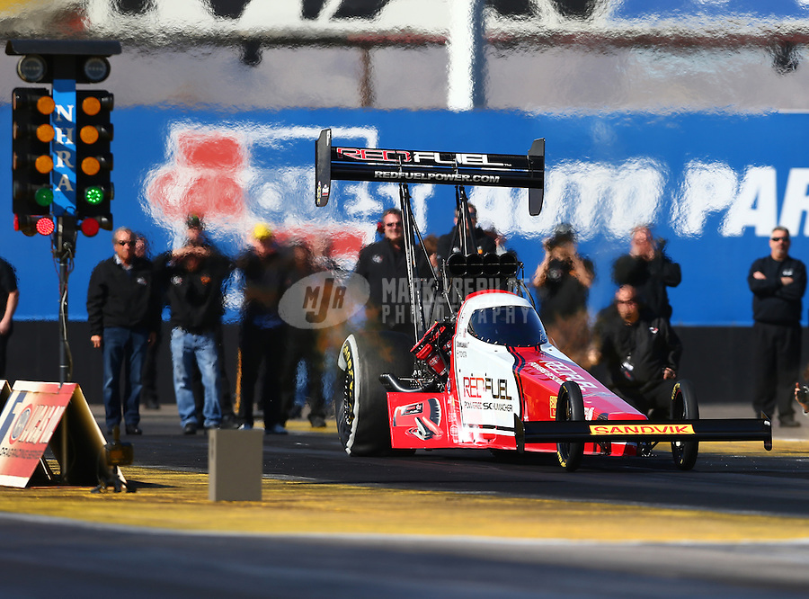 Feb 4, 2016; Chandler, AZ, USA; NHRA top fuel driver Troy Coughlin Jr makes a licensing run during pre season testing at Wild Horse Pass Motorsports Park. Mandatory Credit: Mark J. Rebilas-USA TODAY Sports