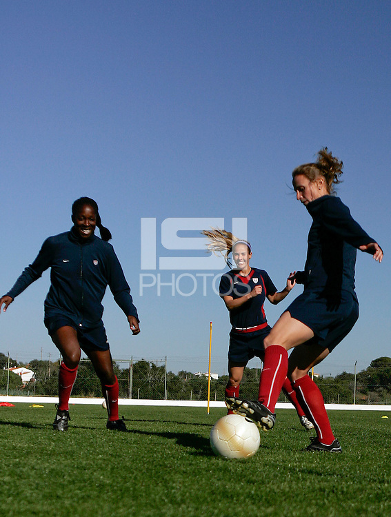 USA´s Tina Frimpong, Heather Mitts and Kristine Lilly in action at the Montechoro Hotel soccer fields in Montechoro, March 11 of 2007, during the Algarve Women´s Cup.
