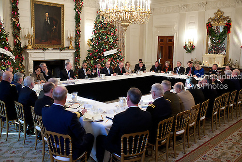 United States President Barack Obama meets with Secretary of Defense Leon Panetta, General Martin Dempsey, Chairman of the Joint Chiefs of Staff, Combatant Commanders, and other Pentagon officials to discuss the Department of Defense budget, in the State Dining Room of the White House in Washington, D.C., December 1, 2011. .Mandatory Credit: Pete Souza - White House via CNP