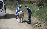 tremendous amounts of flat tires like here for Lorrenzo Manzin (FRA/FDJ) as the race ambulance rushes him by in pursuit of the peloton<br /> <br /> 33th Tro Bro L&eacute;on 2016