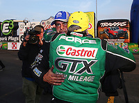Feb 9, 2014; Pomona, CA, USA; NHRA funny car driver John Force (near) hugs Matt Hagan after winning the Winternationals at Auto Club Raceway at Pomona. Mandatory Credit: Mark J. Rebilas-