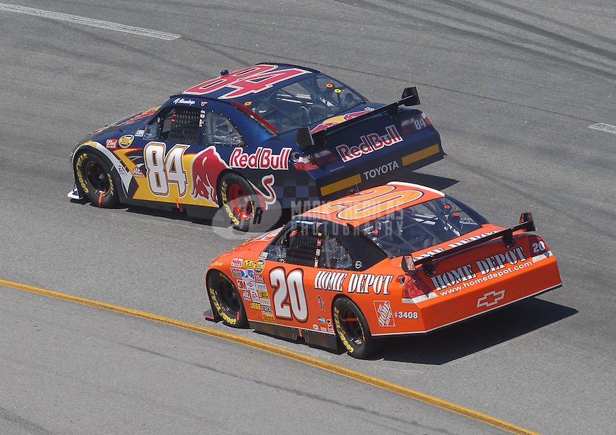 May 6, 2007; Richmond, VA, USA; Nascar Nextel Cup Series driver A.J. Allmendinger (84) leads Tony Stewart (20) during the Jim Stewart 400 at Richmond International Raceway. Mandatory Credit: Mark J. Rebilas