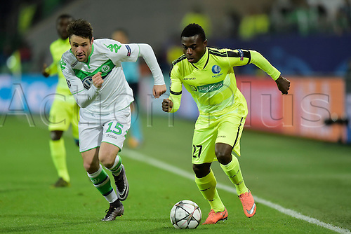 08.03.2016. Wolfsburg, Germany.  Simon Moses Daddy Ajala forward of KAA Gent in action with  Christian Trasch midfielder of VfL Wolfsburg during the Champions League Round of 16, second leg match between VfL Wolfsburg and KAA Gent at the Volkswagen Arena in Wolfsburg, Germany.