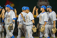 UCLA Bruins celebrate a victory in Game 4 of the 2013 Men's College World Series against the LSU Tigers on June 16, 2013 at TD Ameritrade Park in Omaha, Nebraska. UCLA defeated LSU 2-1. (Andrew Woolley/Four Seam Images)