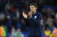 Huddersfield Town Caretaker manager Mark Hudson applauds the fans at the final whistle <br /> <br /> Photographer Ian Cook/CameraSport<br /> <br /> The EFL Sky Bet Championship - Cardiff City v Huddersfield Town - Wednesday August 21st 2019 - Cardiff City Stadium - Cardiff<br /> <br /> World Copyright © 2019 CameraSport. All rights reserved. 43 Linden Ave. Countesthorpe. Leicester. England. LE8 5PG - Tel: +44 (0) 116 277 4147 - admin@camerasport.com - www.camerasport.com