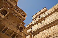 "Jaisalmer the old City and fort.Jaisalmer Fort is one of the largest of desert forts of the world. It is situated in Jaisalmer city in Indian state of Rajasthan. It was built in 1156 AD by the Bhati Rajput ruler Rawal Jaisal, from where it derives it name. The fort stands proudly admist the golden stretches of the great Thar Desert, on Trikuta Hill and had been the scene of many battles. Its massive yellow sandstone walls are a tawny lion color during the day, turning to a magical honey-gold as the sun sets and camouflages the fort making it appear a part of the picturesque yellow desert. Thus, it is also known as the ""Golden Fort"".."