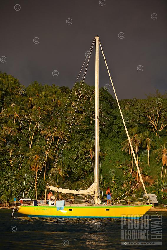 Yacht Bourinasse anchored off Bora Bora at sunset