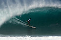 Kainoa McGee on a Stand Up Paddle board 'SUP' at Pipeline on the North Shore in Hawaii