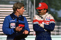 Bobby Rahal speaks with a crew member during practice for the Budweiser 500 on August 26, 1984, at Road America near Elkhart Lake, Wisconsin.