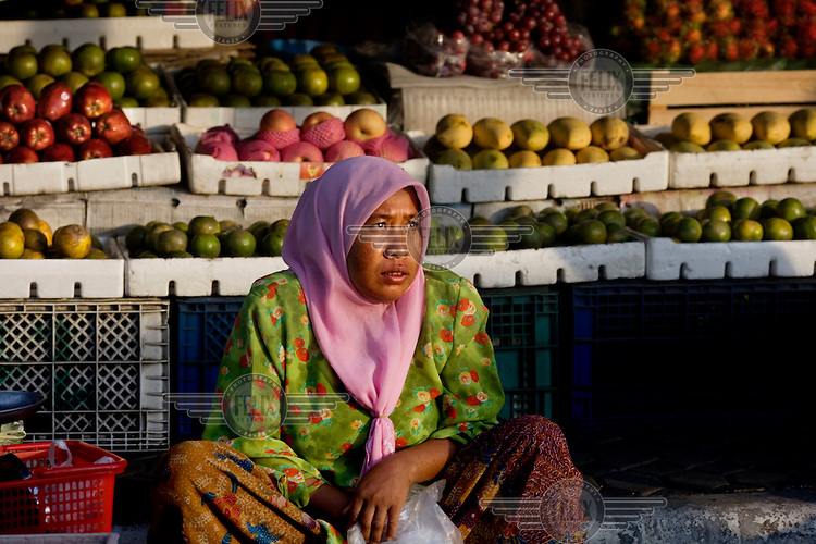 A woman on her market stall in Pattani.