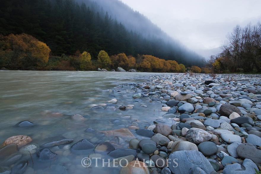 Motueka River in north of South island, morning fog in autumn, New Zealand