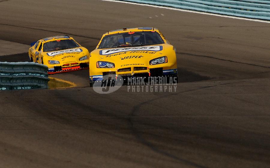 Aug. 12, 2006; Watkins Glen, NY, USA; Nascar Busch Series driver Kurt Busch (39) leads Ryan Newman (02) during the Zippo 200 at Watkins Glen International. Mandatory Credit: Mark J. Rebilas