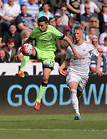 ( L-R ) Jesus Navas of Manchester City followed by Stephen Kingsley of Swansea City during the Swansea City FC v Manchester City Premier League game at the Liberty Stadium, Swansea, Wales, UK, Sunday 15 May 2016