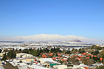 Golan Heights, a view of Kibbutz Merom Golan from Mount Bental, mount Hermon is in the background