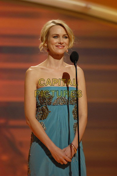 "NAOMI WATTS.Telecast - 64th Annual Golden Globe Awards, Beverly Hills HIlton, Beverly Hills, California, USA..January 15th 2007. .globes half length strapless blue and gold dress silver microphone.CAP/AW.Please use accompanying story.Supplied by Capital Pictures.© HFPA"" and ""64th Golden Globe Awards"""
