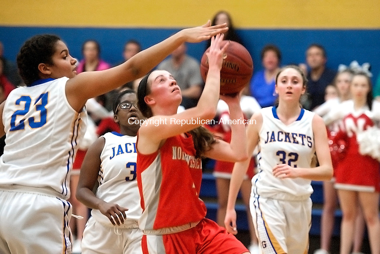 WINSTED, CT--- -011516JS07--Northwestern's Marissa Swartley (4) lays up a shot in front of Gilbert's Deanna Delacruz (23) during their game Friday at the Gilbert School in Winsted. <br />  Jim Shannon Republican-American