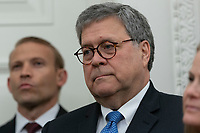 United States Attorney General William P. Barr listens as US President Donald J. Trump presents the Presidential Medal of Freedom to former US Attorney General Edwin Meese at the White House in Washington, DC, October 8, 2019. Meese served from 1985 to 1988 under US President Ronald Reagan.  Credit: Chris Kleponis / Pool via CNP /MediaPunch