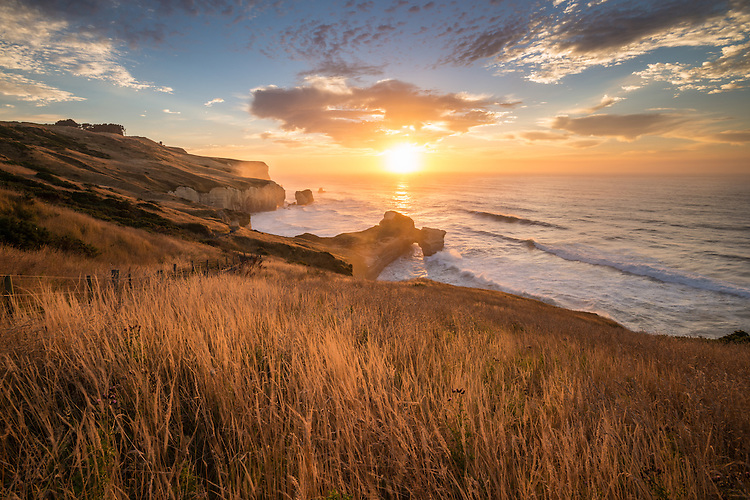 Beautiful golden sunrise over Tunnel beach coastline.  Dunedin New Zealand - stock photo, canvas prints, fine art print