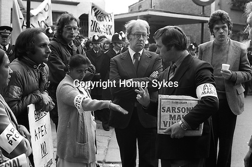 Grunwick Strike North London UK. Mrs Jayaben Desai strike leader on the Picket Line with lawyer ( arms folded) and APEX union official.<br /> <br /> Graham Taylor immediately behind Mrs Desai, he is the co-author of &quot;Grunwick The Workers' Story&quot;. GT worked closely with Mrs Desai during the dispute. He was one of the Trades Council organisers. The TC officers used to organise the picket lines and the local trade unionists, as they knew the law.