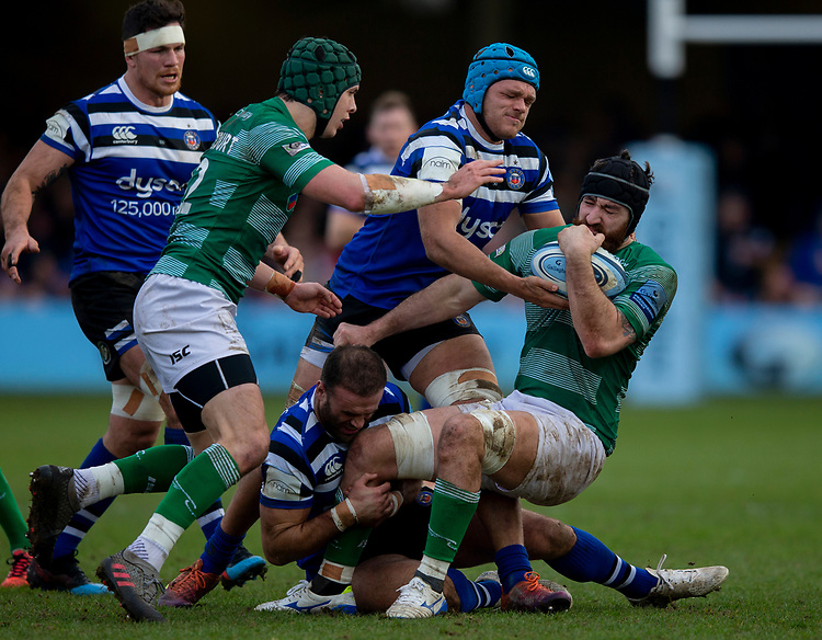 Newcastle's Gary Graham is tackled by Bath's Zach Mercer<br /> <br /> Photographer Bob Bradford/CameraSport<br /> <br /> Gallagher Premiership - Bath Rugby v Newcastle Falcons - Saturday 16th February 2019 - The Recreation Ground - Bath<br /> <br /> World Copyright © 2019 CameraSport. All rights reserved. 43 Linden Ave. Countesthorpe. Leicester. England. LE8 5PG - Tel: +44 (0) 116 277 4147 - admin@camerasport.com - www.camerasport.com