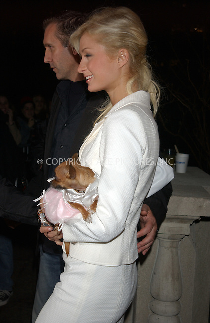 WWW.ACEPIXS.COM . . . . . ....NEW YORK, FEBRUARY 8, 2005....Paris Hilton and Tinkerbell arrive for the Narciso Rodriguez Fall 2005 show.....Please byline: KRISTIN CALLAHAN - ACE PICTURES.. . . . . . ..Ace Pictures, Inc:  ..Philip Vaughan (646) 769-0430..e-mail: info@acepixs.com..web: http://www.acepixs.com