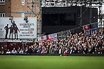 West Ham United 2 Crystal Palace 2, 02/04/2016. Boleyn Ground, Premier League. Home fans in the Bobby Moore Stand watching the second-half action at the Boleyn Ground as West Ham United hosted Crystal Palace in a Barclays Premier League match. The Boleyn Ground at Upton Park was the club's home ground from 1904 until the end of the 2015-16 season when they moved into the Olympic Stadium, built for the 2012 London games, at nearby Stratford. The match ended in a 2-2 draw, watched by a near-capacity crowd of 34,857. Photo by Colin McPherson.