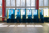 People vote inside typical voting booths in gymnasium 4.