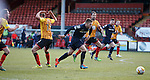 Marcus Fraser runs through the Partick Thistle defenders to score the killer third goal for Ross County