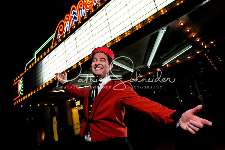 A period usher welcomes visitors to Charleston, SC's Riviera Theater, located at 225 King Street, downtown. Once the home of first-run pictures, the romantic-Art Deco-style theater is today a conference center and ballroom. Messages may be added to marquee via Photoshop (model released).