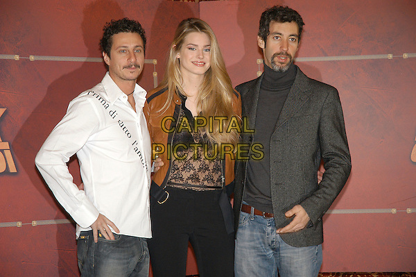 """LUCA BIZZARRI, VANESSA HESSLER & PAOLO KESSISOGLU .Photocall for """"Asterix aux jeux olympiques"""" (Asterix at the Olympic Games), Rome, Italy..January 28th, 2008.half length black lace see through thru top leather jacket brown white shirt grey gray goatee facial hair .CAP/CAV.©Luca Cavallari/Capital Pictures. *** Local Caption *** ."""