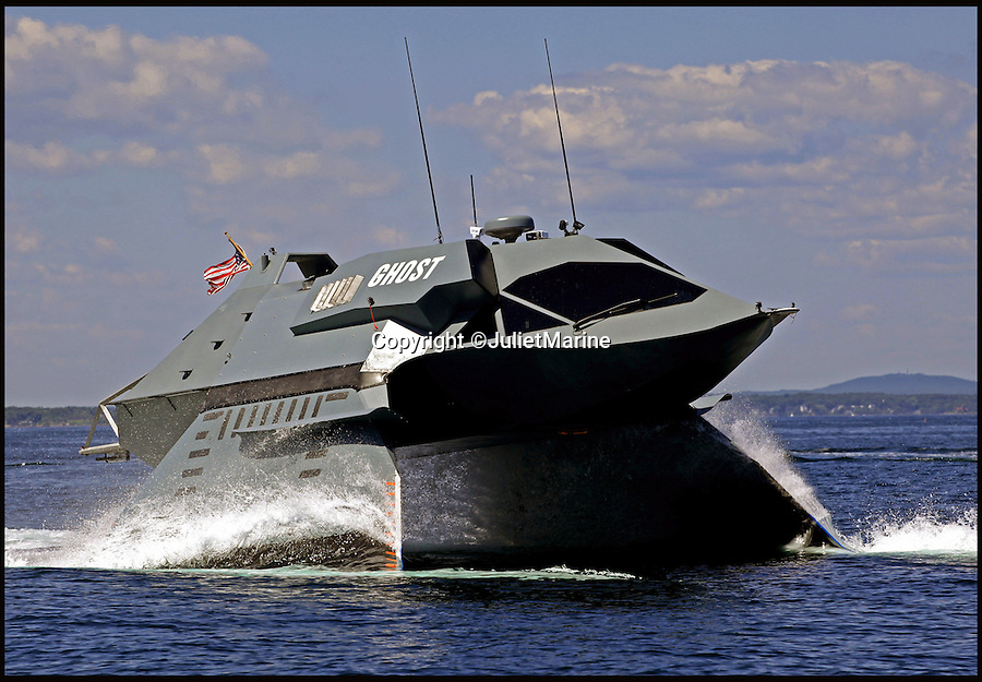 BNPS.co.uk (01202 558833)<br /> Pic: JulietMarine/BNPS<br /> <br /> This sinister looking craft might resemble Darth Vader's imperial shuttle in Star Wars but it is actually a high-speed boat that uses its clever design to reduce the risk of seasickness.<br /> <br /> The vessel, called Ghost, uses two 12ft winged struts that stand on twin hulls to lift the main craft clear out of the water.<br /> <br /> This allows the Ghost to reach speeds of 33 knots even when faced with waves of 8ft high.