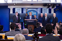 United States President Donald J. Trump, joined by members of the Coronavirus Task Force, makes remarks on the Coronavirus crisis in the Brady Press Briefing Room of the White House in Washington, DC on Saturday, March 21, 2020.  Credit: Stefani Reynolds / Pool via CNP/AdMedia