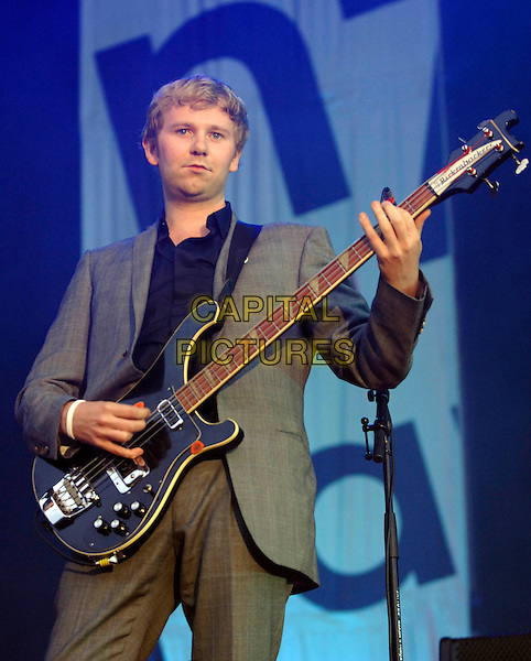 FRANZ FERDINAND - ROBERT HARDY.V Festival 2005, Hylands Park.Chelmsford, Essex, England, UK.August 21st, 2005.virgin music live on-stage stage performing v-festival v2005 concert live gig performance half length bass .www.capitalpictures.com.sales@capitalpictures.com.©Capital Pictures