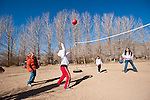 Kids play ball on the playground during recess on a chilly day, Denio, Nev.