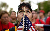 1070MCSO  165737 1070firstday 7/29/10- Maria Zamora, of Los Angeles (CQ), holds an American FLag while listening to a speaker outside the Arizona State Capitol. She was on one of 11 busses of protestors from LA that came to Arizona to protest against SB1070.  (Pat Shannahan/ The Arizona Republic)