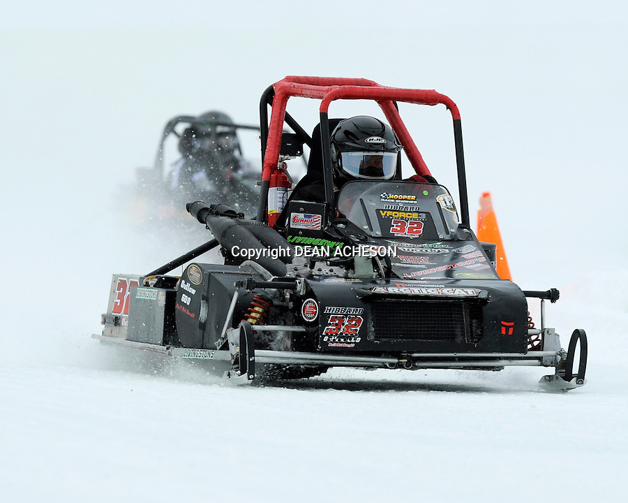 Tim Hibbard of Lempster, NH powers his Outlaw 600 through turn two at the AMSOIL World Championship Snowmobile Derby on Sunday, Jan. 19.