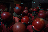 Members of the Red Ants waiting inside a so-called 'hijacked' building during an operation to clear the block of its illegal occupants. The Red Ants are a controversial private security company often hired to clear squatters from land and so-called 'hijacked' properties.