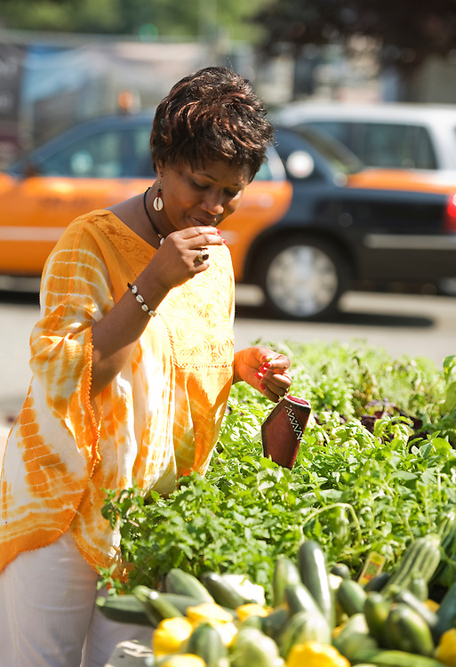 UNITED STATES - JUNE 08: Olivia Achucko samples herbs from Richfield Farm in Manchester, Md., at the NOMA farmer's market at 1st and M Streets, NE. (Photo By Tom Williams/Roll Call)