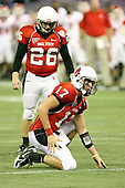 January 5th, 2008:  Ball State holder Tanner Justice (17) calls for the ball as place kicker Ian McGarvey (26) prepares for an extra point attempt during the fourth quarter of the International Bowl at the Rogers Centre in Toronto, Ontario Canada...Rutgers defeated Ball State 52-30.  ..Photo By:  Mike Janes Photography