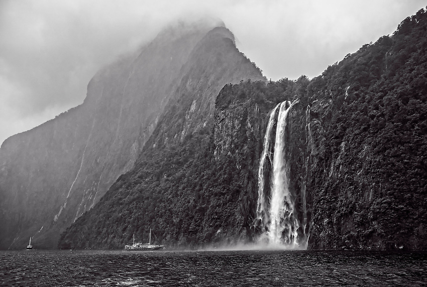 Milford Sound from a boat on a rainy, foggy morning