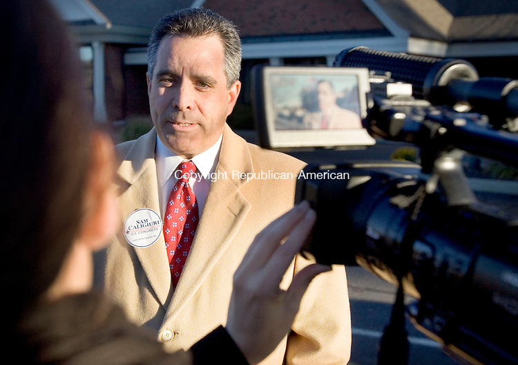 SOUTHBURY, CT. 02 November 2010-110210SV02--Sam S. F. Caligiuri Republican candidate for the 5th district talks with reporters at the Sacred Heart church in Southbury Tuesday.<br /> Steven Valenti Republican-American